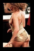 kylie in gold hot pants